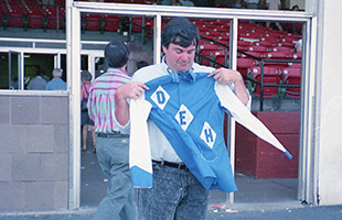 Jim holding up the silks of his DEH Racing Stable